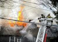 Bethel and Stony Hill fire departments responded to a fire at a home on Blackman Avenue in Bethel, Conn., Monday, Dec. 22, 2014.