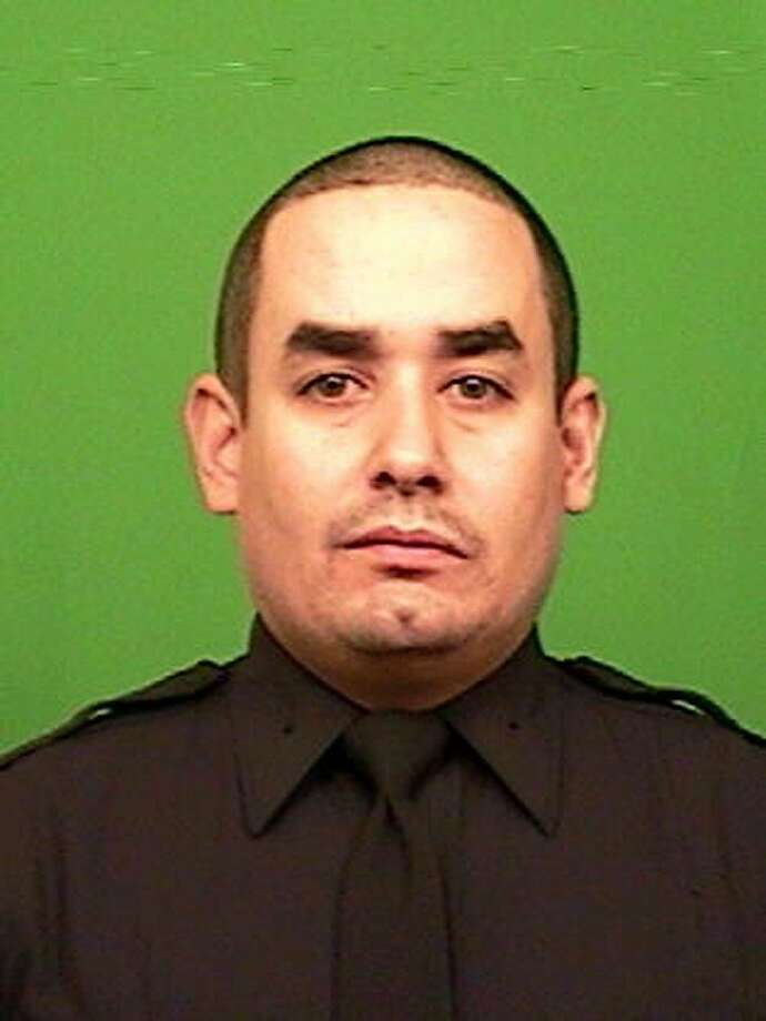 This photo provided by the New York Police Department shows officer Rafael Ramos. Ramos and officer Wenjian Liu were shot and killed Saturday, Dec. 20, 2014, in the Brooklyn borough of New York. The suspect, 28-year-old Ismaaiyl Brinsley, ran to a subway station and killed himself. (AP Photo/New York Police Department) Photo: Associated Press