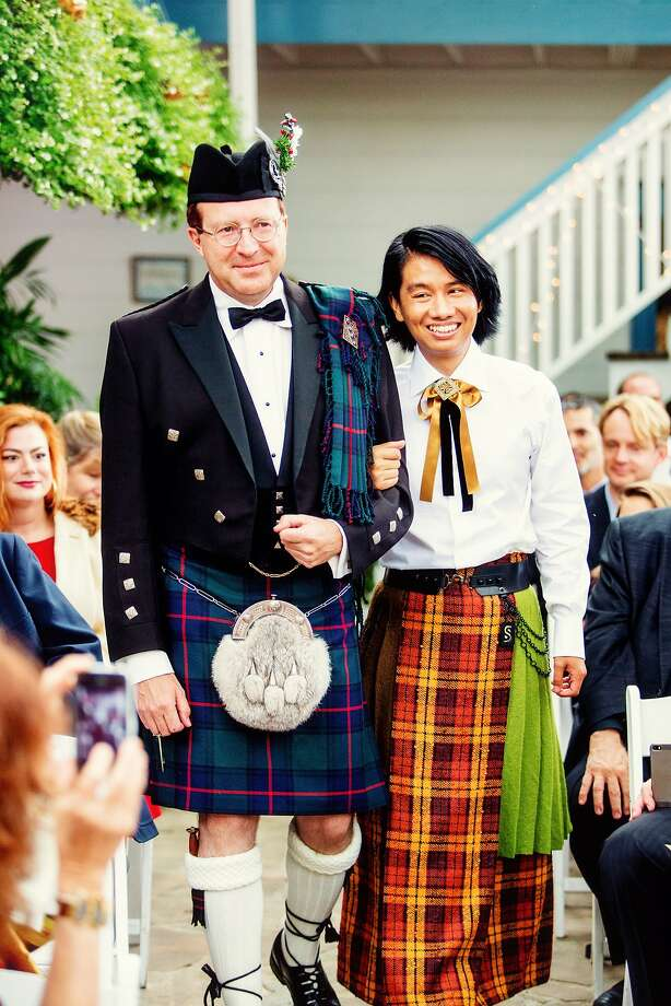 Sam Shan and William Miller wed on Sept. 27, 2014 at the Mill Rose Inn in Half Moon Bay. William wore his kilt in the Shaw tartan in deference to his mother's Scottish heritage. Sam wore a longyi, as men wear in Myanmar, of his own design. Photo: Jasmine Wang