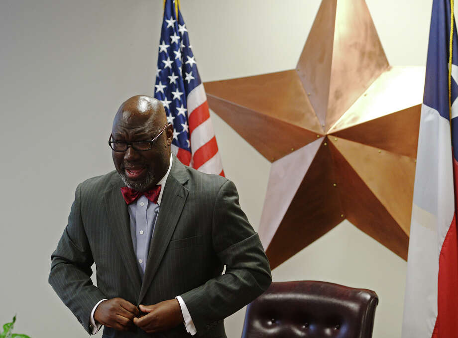 Texas Commissioner of Education Michael Williams buttons his jacket after a brief press conference Monday. Williams spoke with the media at the Region 5 Education Service Center on Monday afternoon. Photo taken Monday 7/21/14 Jake Daniels/@JakeD_in_SETX Photo: Jake Daniels / ©2014 The Beaumont Enterprise/Jake Daniels