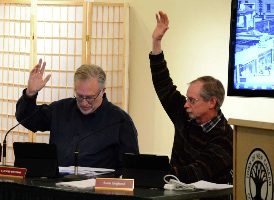 Town Council members Sven Englund, right, and Roger Williams at a meeting Wednesday, Dec. 17, 2014, at the New Canaan Nature Center, New Canaan, Conn. The panel unanimously voted that night to adopt a three-year contract with more than 30 Town Hall employees who unionized last December. Photo: Nelson Oliveira / New Canaan News