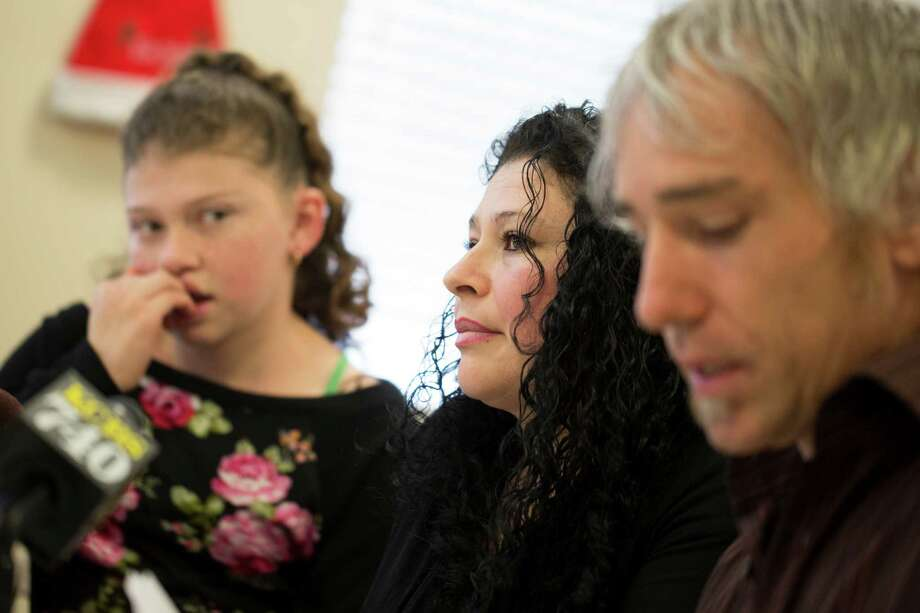 Maricela Perez, center, wife of Pedro Perez, a San Leandro man who fell from an 11-story building in San Francisco while window washing, speaks about her husband's recovery with her daughter Gaby Perez, 11, left, and Colin O'Leary, right, a Service Employees International Union organizer, at the SEIU United Service Workers West office in Oakland, Calif. on Monday, December 22, 2014. Photo: Tim Hussin / Special To The Chronicle / ONLINE_YES