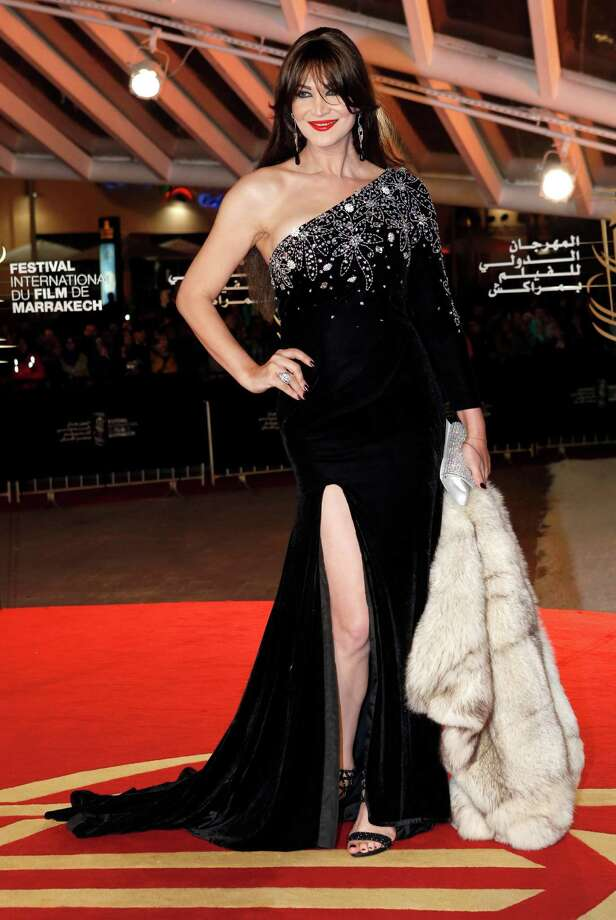 Moroccan transgender actress and famed belly dancer Noor Talbi poses for photo graphers as she arrives at the Marrakech International Film Festival. In this conservative Muslim country, where homo sexuality is illegal, Noor is not only accepted, but is also a celebrity. Photo: Abdeljalil Bounhar / Associated Press / AP