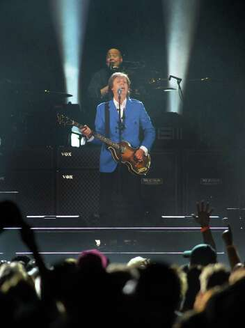 """Paul McCartney performs at the Times Union Center Saturday July 5, 2014, in Albany, NY. seen above McCartney is drummer Abraham """"Abe"""" Laboriel, Jr.   (John Carl D'Annibale / Times Union) Photo: John Carl D'Annibale / 00027433A"""