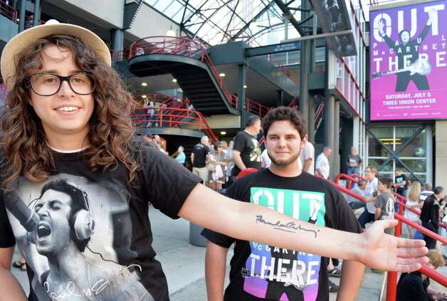 Jessica Dionne shows off a tattooed Paul McCartney autograph from a 2010 concert as she and Alexander McCulloch, both of Montreal at the Times Union Center before the Paul McCartney Out There tour concert Saturday July 5, 2014, in Albany, NY.  (John Carl D'Annibale / Times Union) Photo: John Carl D'Annibale / 00027433A