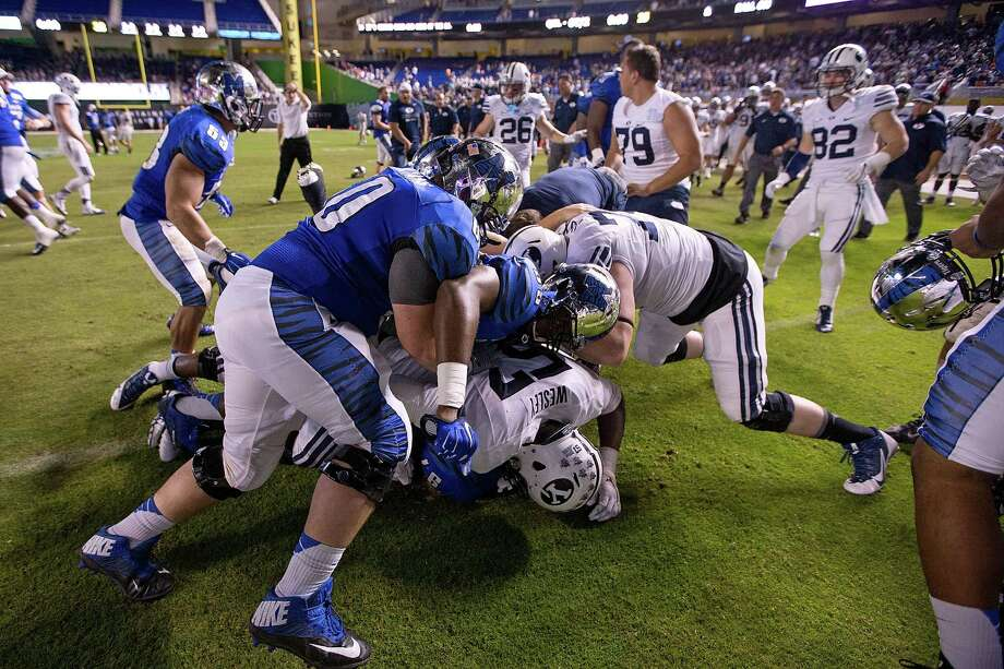 Memphis and BYU players fight after Memphis' overtime win in Monday's Miami Beach Bowl. Photo: Rob Foldy / Getty Images / 2014 Getty Images