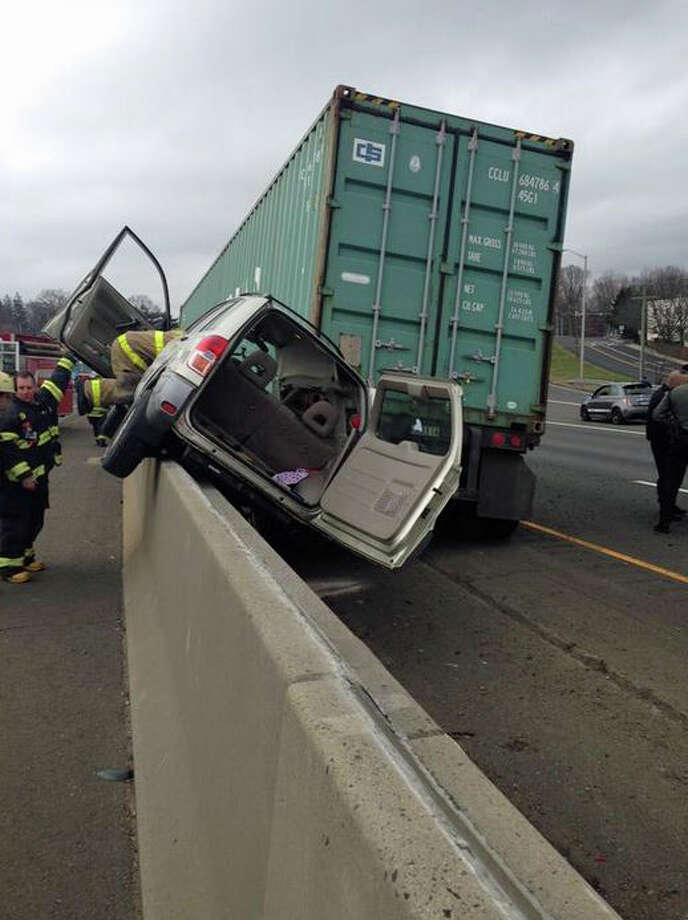 A passenger vehicle was forced onto the barrier on I-95 Monday by a trailer that became detached from its cab. Photo: Contributed Photo/Greenwich Fire, Contributed Photo / Greenwich Time Contributed
