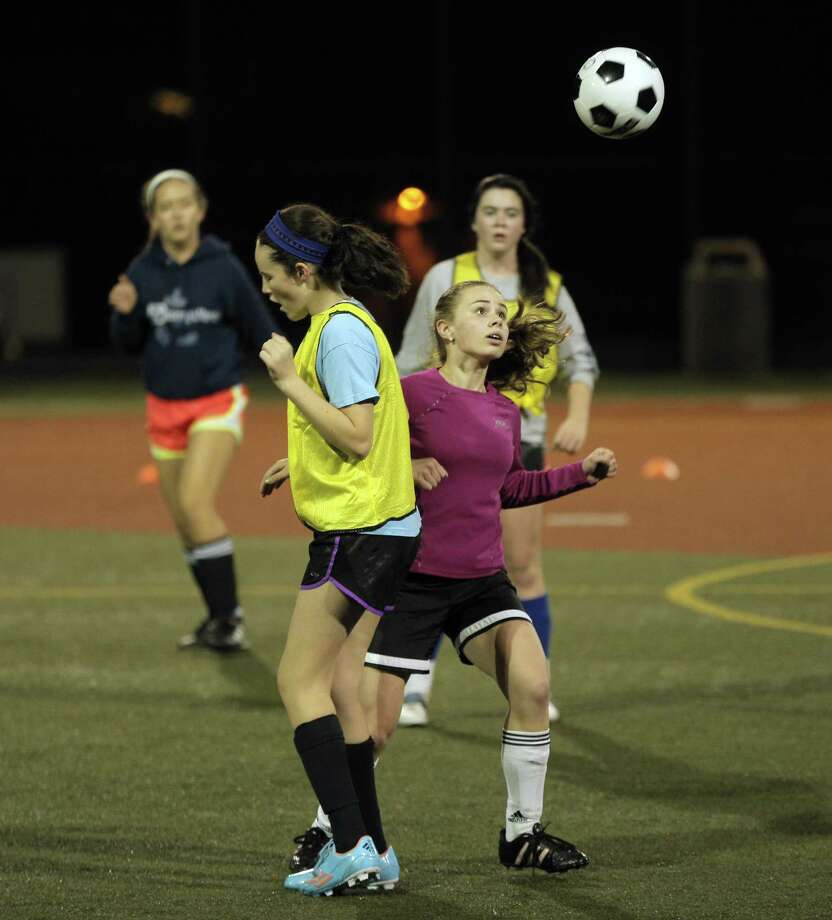 Julia Kelly, left, and Molly Finnegan practice for the St. Brendan Bears eighth grade CYO Division 1 soccer team. Photo: Carlos Avila Gonzalez / The Chronicle / ONLINE_YES