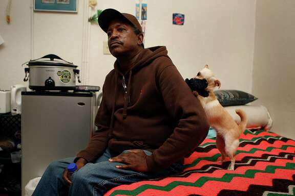 Ralph Cooper, who lives at the Coronado Hotel with his dog, Baby Girl,  a 63-year-old resident of the Coronado Hotel  Ralph with his dog, Baby Girl, talks about how he cooks in his apartment in San Francisco, Calif., on Wednesday, December 10, 2014.