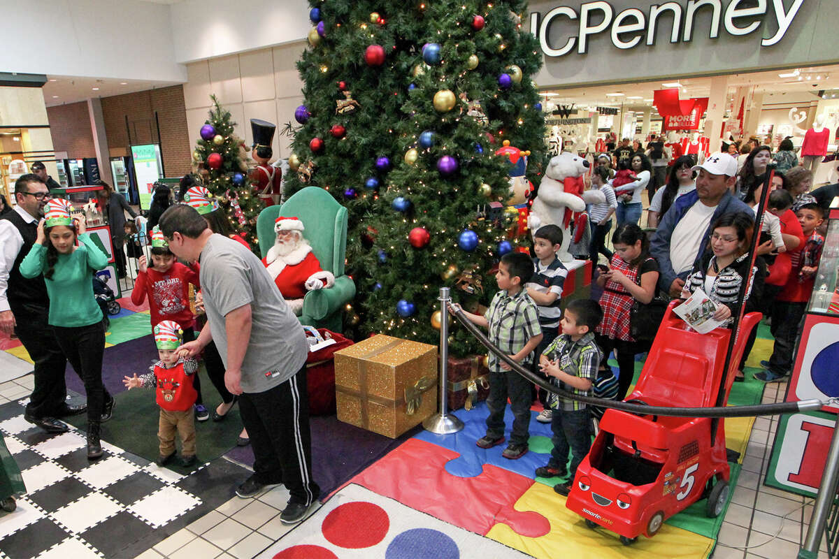 Children wait to visit with Santa at South Park Mall on Monday, Dec. 22, 2014. MARVIN PFEIFFER/ mpfeiffer@express-news.net