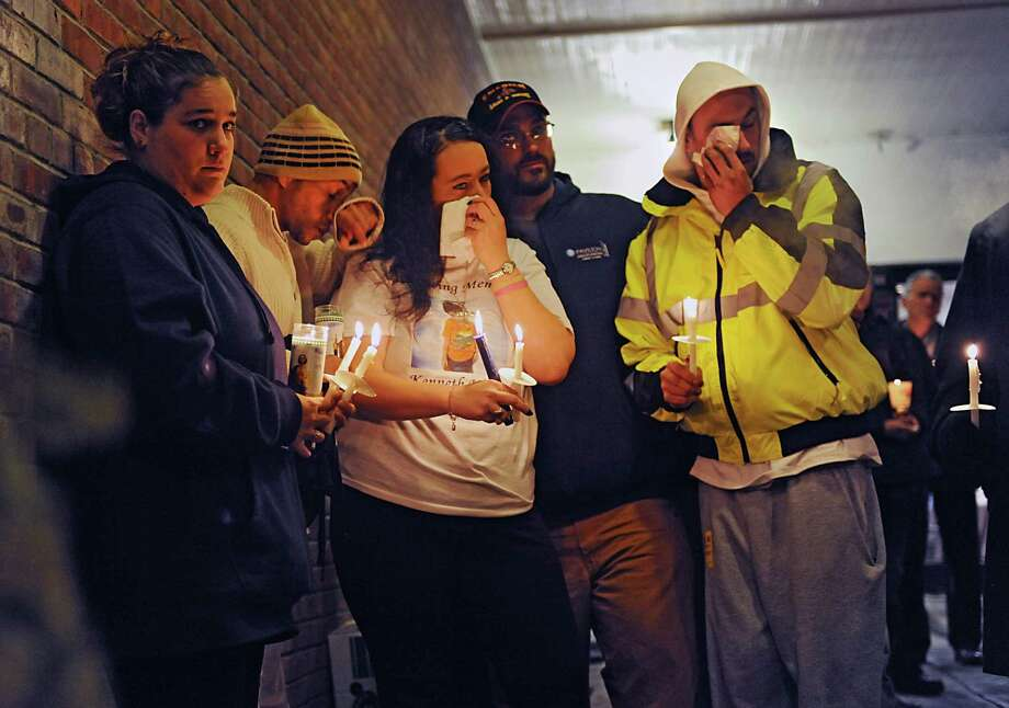 Family members get emotional as community members come together for a vigil to honor Kenneth White in front of the Berne-Knox-Westerlo Elementary School on Monday, Dec. 22, 2014 in Berne, N.Y. White was killed last week. A suspect is in custody. (Lori Van Buren / Times Union) Photo: Lori Van Buren, Albany Times Union / 00029956A
