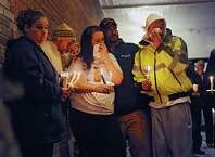 Family members get emotional as community members come together for a vigil to honor Kenneth White in front of the Berne-Knox-Westerlo Elementary School on Monday, Dec. 22, 2014 in Berne, N.Y. White was killed last week. A suspect is in custody. (Lori Van Buren / Times Union)