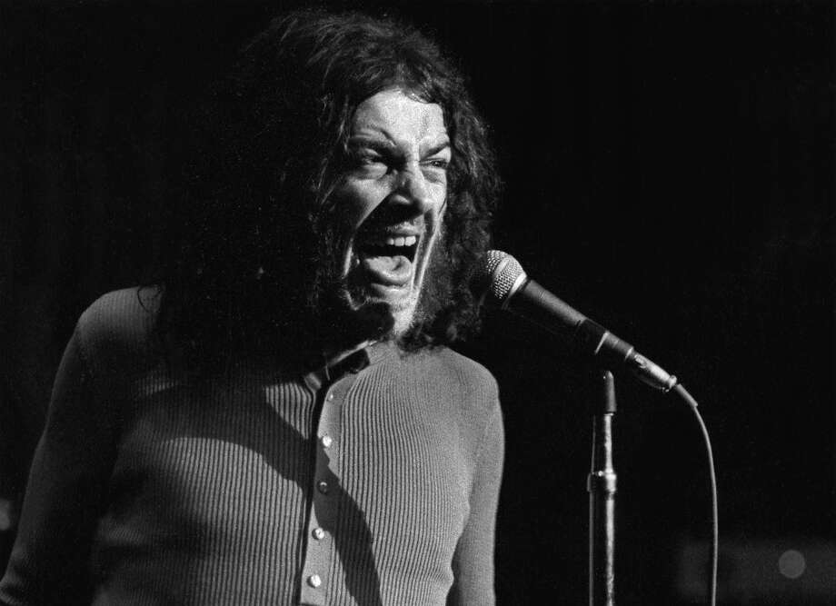 "FOR ONE TIME USE ONLY WITH OBITUARY - In this June 1970 photo released by Linda Wolf, British singer Joe Cocker performs during the Joe Cocker - Mad Dogs & Englishmen tour and traveling party. Cocker, the raspy-voiced British singer known for his frenzied cover of ""With a Little Help From My Friends,"" and the teary ballad ""You Are So Beautiful,"" died of lung cancer on, Monday, Dec. 22, 2014 in Colorado. He was 70. (AP Photo/www.lindawolf.net, Linda Wolf) Photo: Linda Wolf, Associated Press"