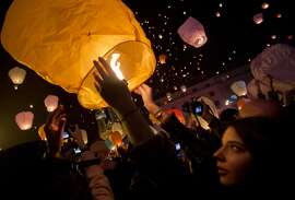 Paper lanterns are released as a part of Christmas festivities in Zagreb, Croatia, Monday, Dec. 22, 2014. (AP Photo/Darko Bandic)