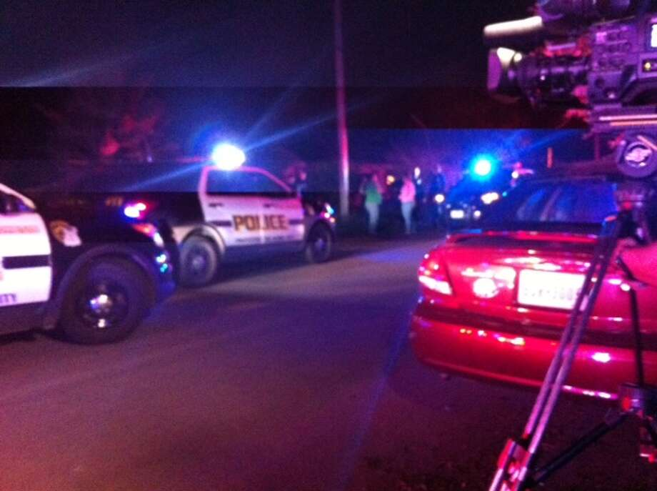 San Antonio police and fire units were at the scene of a shooting in the 200 block of Ada on the Southeast Side. Photo: SAEN/Elizabeth Zavala