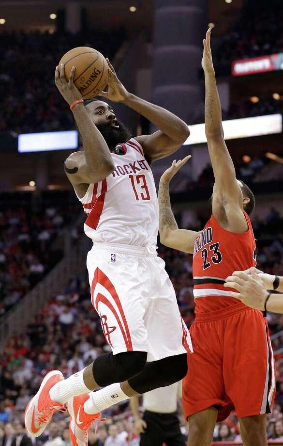 Houston Rockets' James Harden (13) shoots over Portland Trail Blazers' Allen Crabbe (23) in the second half of an NBA basketball game Monday, Dec. 22, 2014, in Houston. The Rockets won110-95. (AP Photo/Pat Sullivan) ORG XMIT: HTR116 Photo: Pat Sullivan / AP