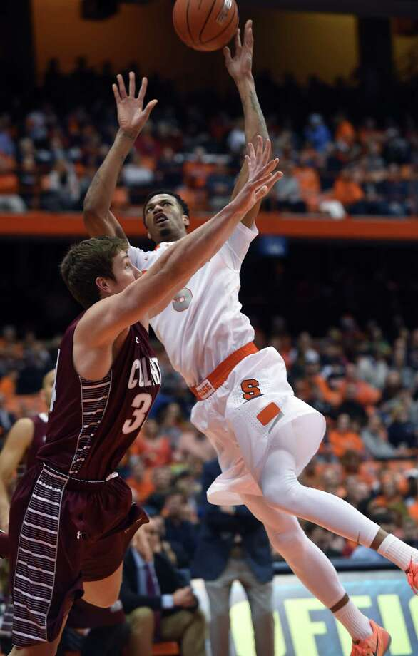 Syracuse's Chris McCullough shoots over Colgate's John Fenton during the second half of an NCAA college basketball game in Syracuse, N.Y., Monday, Dec. 22, 2014. (AP Photo/Kevin Rivoli) ORG XMIT: NYKR106 Photo: KEVIN RIVOLI / FR60349 AP