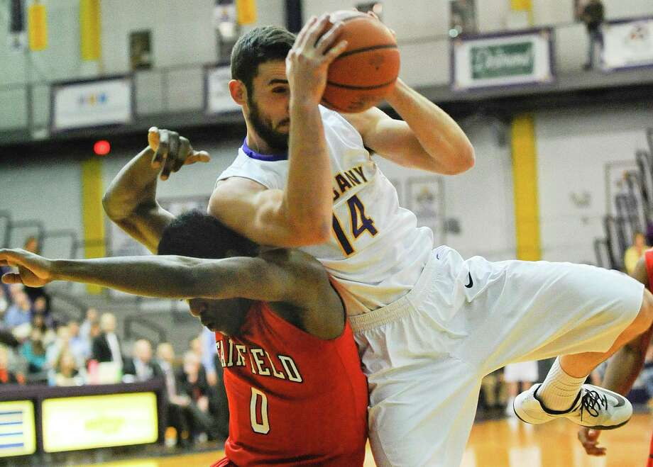UAlbany's  Sam Rowley (14) is defended by Fairfield's Mike Kirkland Jr. (0) during an NCCA basketball game in Albany, N.Y., Monday, Dec. 22, 2014. (Hans Pennink / Special to the Times Union)    ORG XMIT: HP101 Photo: Hans Pennink / Hans Pennink