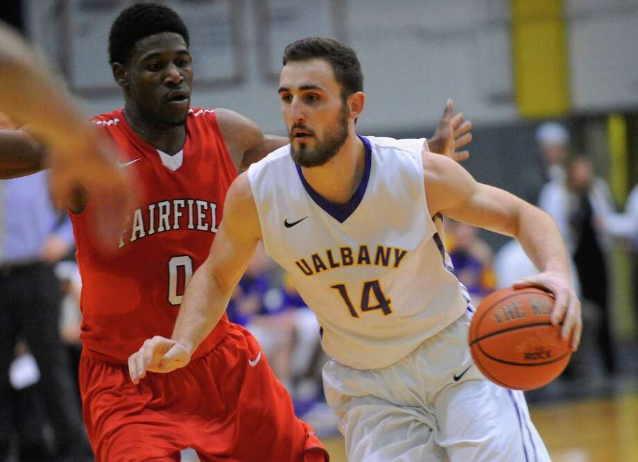 UAlbany's Sam Rowley (14) is defended by  Fairfield's Mike Kirkland Jr. (0) during an NCCA basketball game in Albany, N.Y., Monday, Dec. 22, 2014. (Hans Pennink / Special to the Times Union)    ORG XMIT: HP112 Photo: Hans Pennink / Hans Pennink