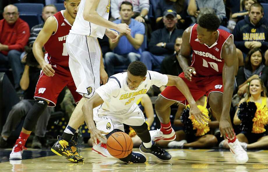 Guard Tyrone Wallace, who led Cal with 17 points and seven rebounds, dives for a loose ball in the loss to Wisconsin. Photo: Beck Diefenbach / Associated Press / FR170639 AP