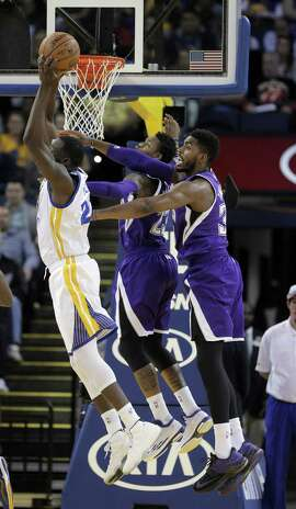 Draymond Greene (23) pulls in a rebound during the first half as the Golden State Warriors played the Sacramento Kings at Oracle Arena in Oakland, Calif., on Monday, December 22, 2014.
