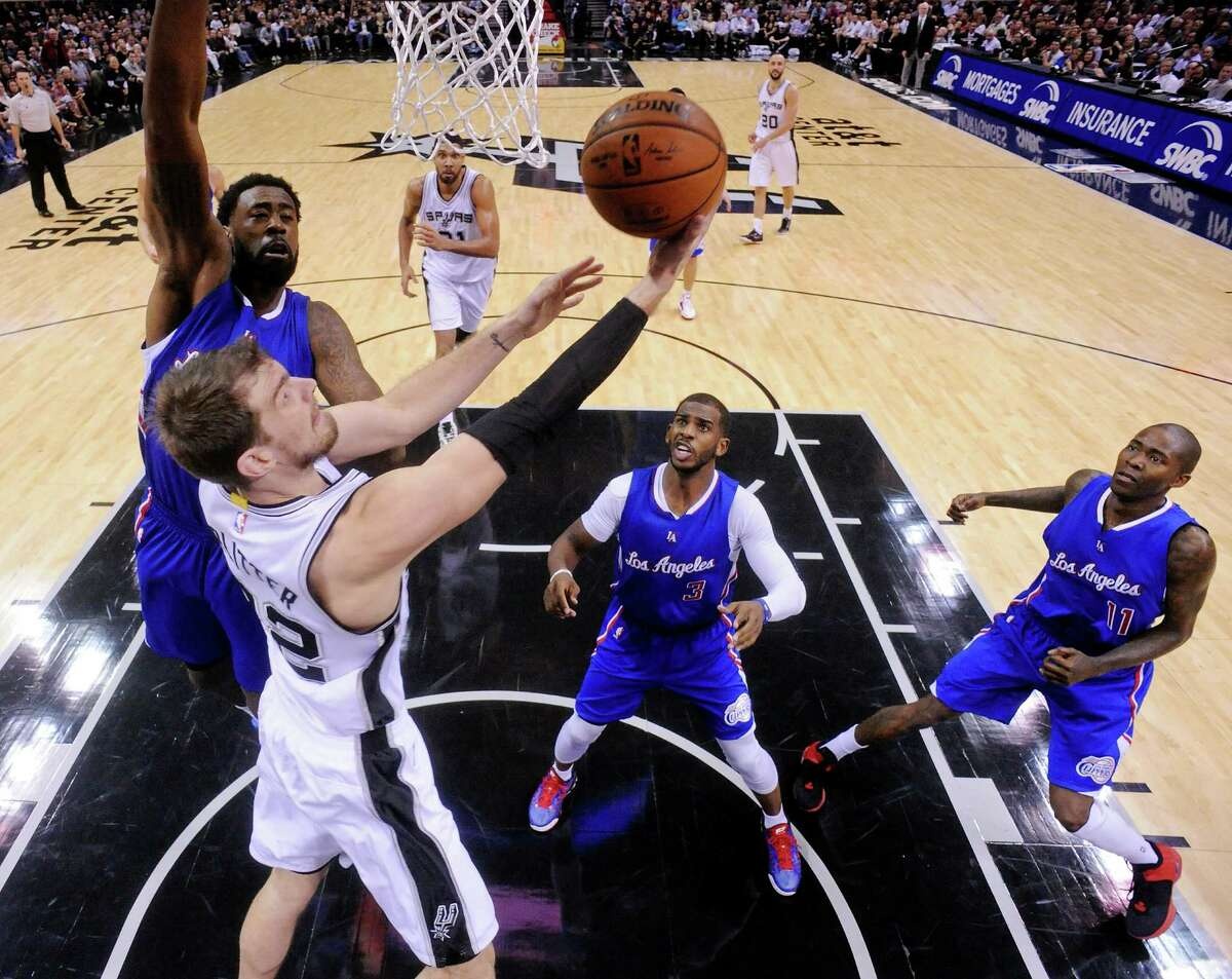 San Antonio Spurs' Tiago Splitter shoots around Los Angeles Clippers' DeAndre Jordan (left) as Chris Paul and Jamal Crawford look on during second half action Monday Dec. 22, 2014 at the AT&T Center. The Spurs won 125-118.