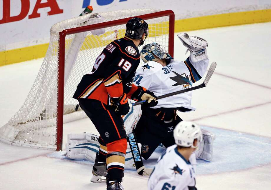 San Jose Sharks goalie Antti Niemi misses the save while Anaheim Ducks left wing Patrick Maroon watches the game winning goal fall behind Niemi during the overtime period of an NHL hockey game Monday, Dec. 22, 2014, in Anaheim, Calif. The goal was scored by Anaheim Ducks' Ryan Kesler for a 3-2 victory. .  (AP Photo/Lenny Ignelzi) Photo: Lenny Ignelzi / Associated Press / AP