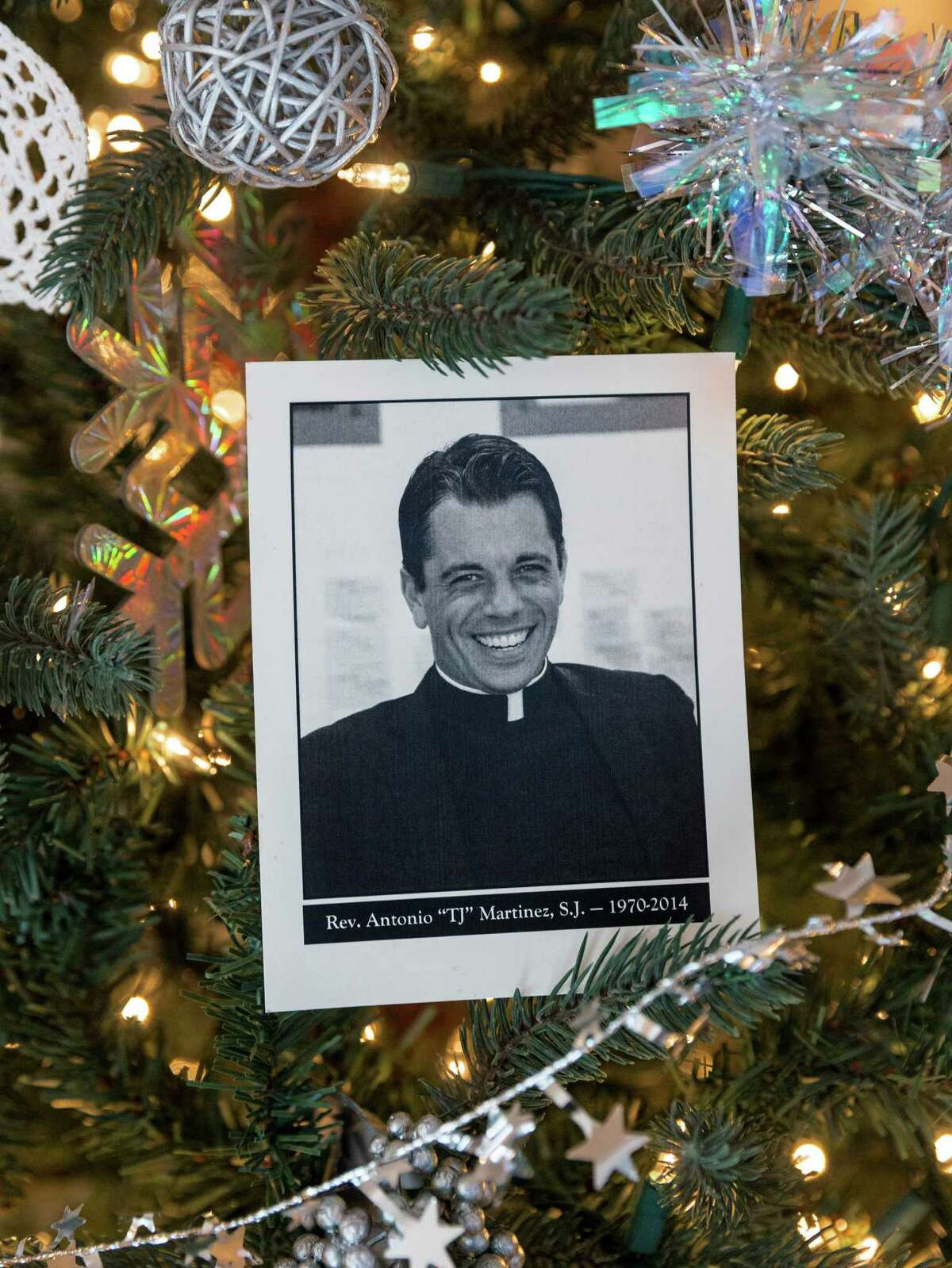 Father T.J. Martinez on the Christmas Tree.
