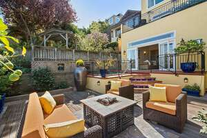 The backyard offers plenty of area for planting and entertaining.