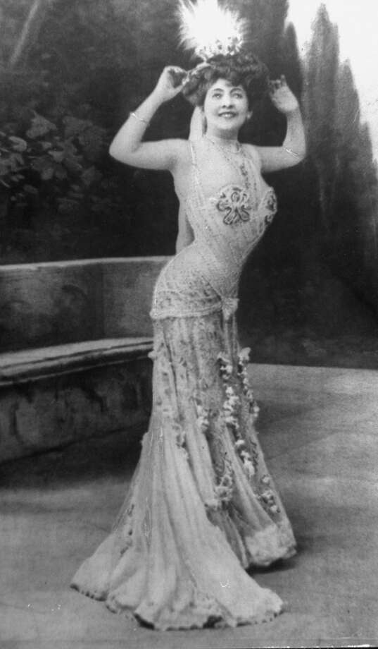 French actress posing for cameo modelling what a lady of fashion would be wearing to a soiree during the Belle Epoque. Photo: Time Life Pictures, The LIFE Picture Collection/Gett