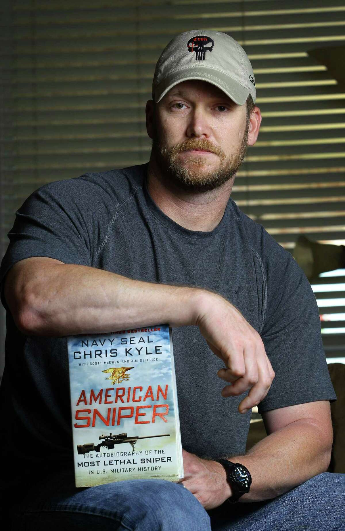 """In this April 6, 2012 file photo, Chris Kyle, a former Navy SEAL and author of the book """"American Sniper,"""" poses in Midlothian, Texas. Kyle and his friend Chad Littlefield were fatally shot at a shooting range southwest of Fort Worth, Texas, on Saturday, Feb. 2, 2013. Former Marine Eddie Ray Routh, who came with them to the range, has been arrested for the murders. (AP Photo/The Fort Worth Star-Telegram, Paul Moseley, File)"""