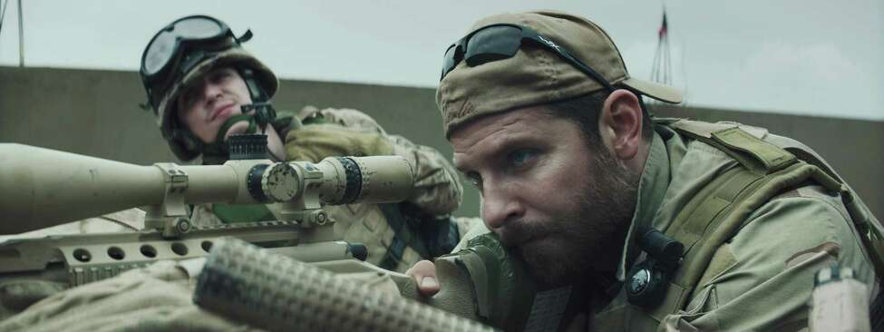 Kyle Gallner, left, as Goat-Winston and Bradley Cooper as Chris Kyle in Warner Bros. Pictures' and Village Roadshow Pictures' drama