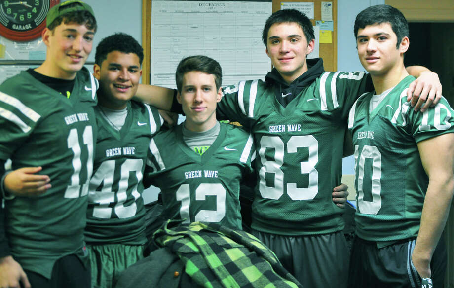 Delivering coats to the Thrift Mart of New Milford are New Milford High School football players, from left to right, Danny Flynn, Andre Taylor, Jacob Plancon, Patrick Ryan and Chris Ryan. December 2014  Courtesy of Beverly Ryan Photo: Contributed Photo / The News-Times Contributed