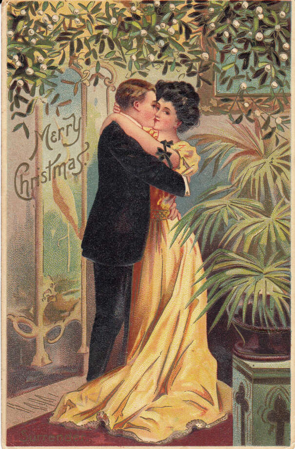 Between 1907 and 1910, Christmas postcards created a visual conversation between Americans that was a forerunner of today's holiday pictures on social media. Then, as now, social media reveals what Americans are talking about in their lives. In this period card, a young woman takes control of the mistletoe. / ONLINE_YES