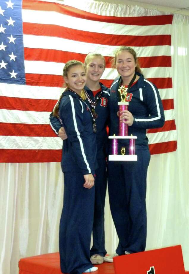 Darien Level 8 gymnasts Perri Mirabile, Jessica Freiheit and Sam Gunn won the first place team trophy at the Snowflake Invitational meet in Wilton. Mirabile also won the All Around title for her age group. Photo: Contirbuted, Contributed / Darien News