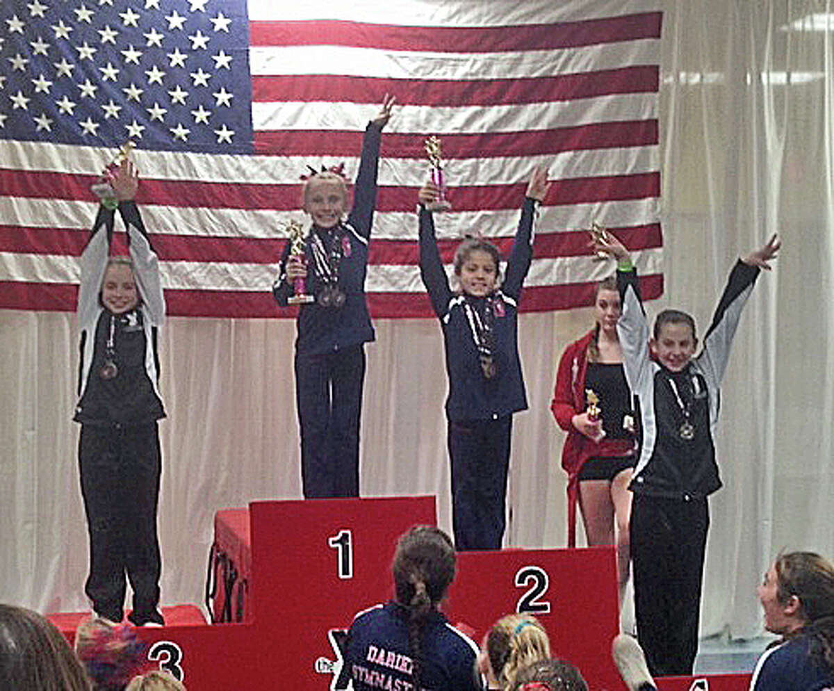 New Canaan resident Leah Wall won the Level 5 All Around title for her age group at the Snowflake Invitational in Wilton, with Darien YMCA teammate Tori Ware taking second.