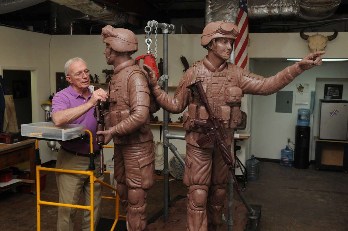 Edd Hayes, of Atascocita, works on his Way Home sculpture, a veteran memorial to be placed in Town Green Park in The Woodlands, at his studio in Humble. The sculpture depicts U.S. soldiers Zachary Endsley, left, and Cory Kosters, both of The Woodlands, who were killed in action.
