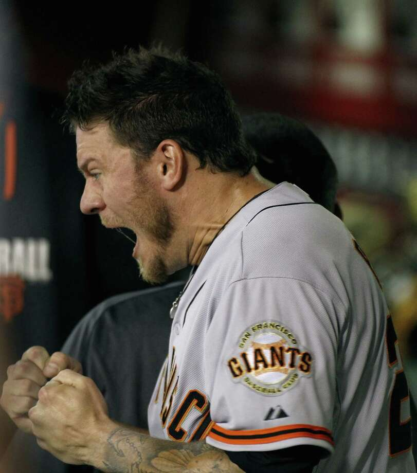 PHOENIX, AZ - SEPTEMBER 16:  Starting pitcher Jake Peavy #22 of the San Francisco Giants reacts after being taken out of the game during the eighth inning of a MLB game against the Arizona Diamondbacks at Chase Field on September 16, 2014 in Phoenix, Arizona.  (Photo by Ralph Freso/Getty Images) Photo: Ralph Freso / Getty Images / ONLINE_CHECK
