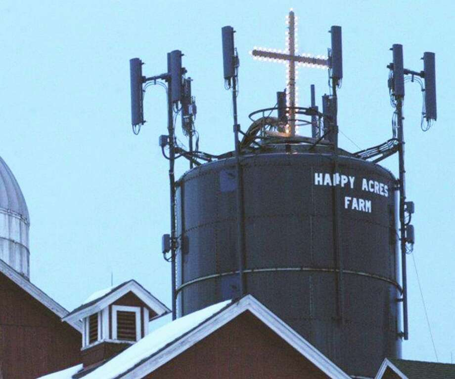 Sherman selectmen have decided to take down a cross which had graced Happy Acres Farm during the holidays in recent years. December 2014 Photo: Norm Cummings / The News-Times