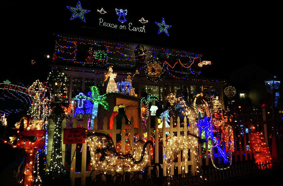 "This brightly lighted Roseville Terrace home practically shouts, ""Happy Holidays!"" Photo: Genevieve Reilly / Fairfield Citizen"