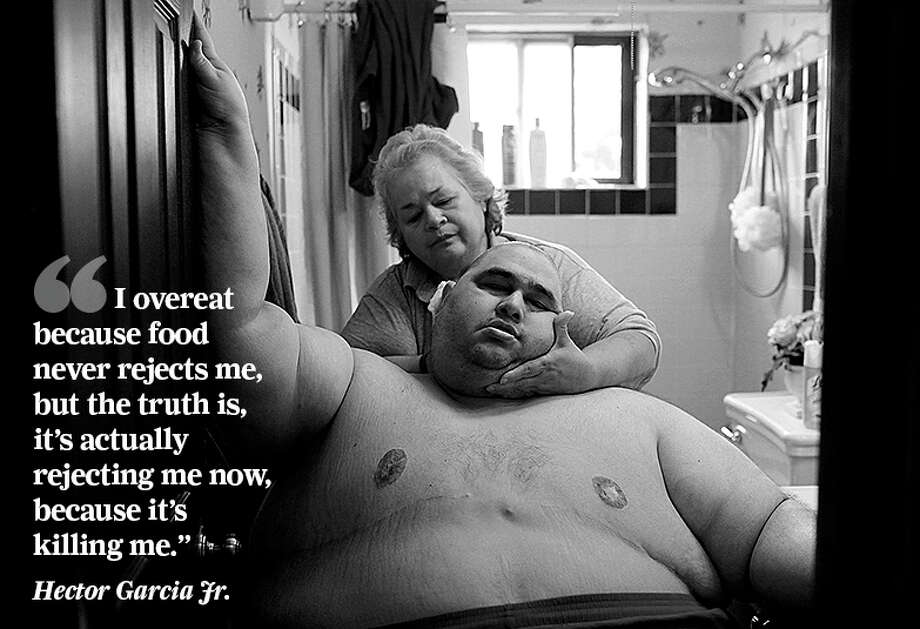 At nearly 600 pounds, Hector Garcia Jr. had to struggle to get to the bathroom across the hall from his bedroom so that his mother, Elena, could wash him after having cut his hair in November 2010. A month before, Hector started dieting after he realized he was close to his highest known weight, 636 pounds. Photo: Lisa Krantz /San Antonio Express-News / San Antonio Express-News