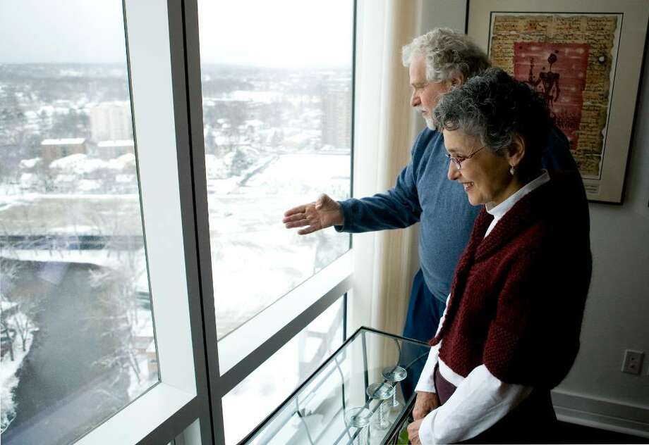 Saul (left) and Mimi Cohen look out the window of their 3-bedroom, 21st floor apartment in Trump Parc on February 24, 2010. One of the views overlooks Mill River. Photo: Kerry Sherck / Stamford Advocate Freelance