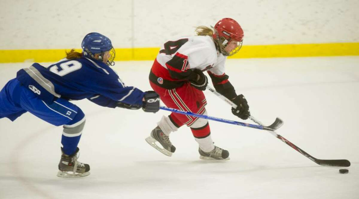 New Canaan's Shelby Barada, right, and Darien's Madeline Coburn, left, during the FCIAC girls hockey championship at Terry Conners Rink in Stamford, Conn. on Saturday, Feb. 27, 2010.