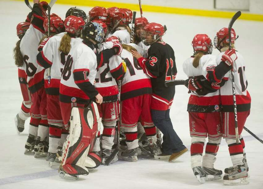The New Canaan Rams celebrate their 3-0 victory over the Darien Blue Wave in the FCIAC girls hockey championship at Terry Conners Rink in Stamford, Conn. on Saturday, Feb. 27, 2010.