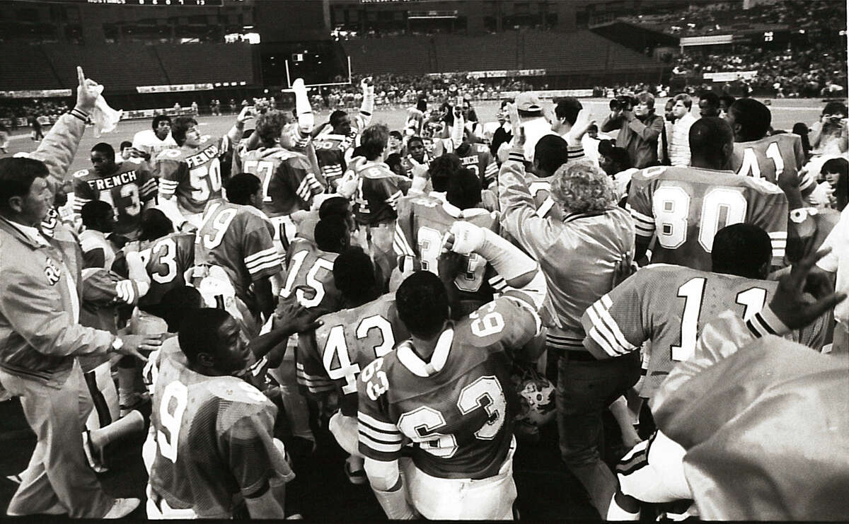 French High School players and coaches celebrate after their 48-13 win over Aldine during the 1984 bi-district game in Houston. The Buffalos were picked as 31-point underdogs. Enterprise file photo