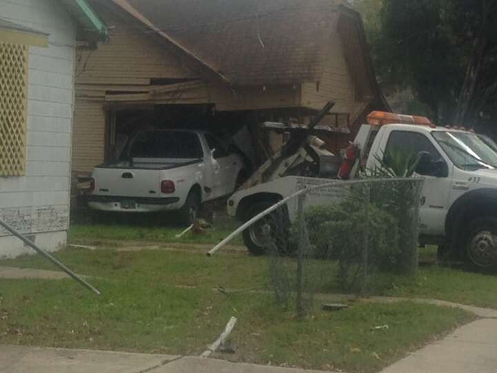 A woman and a young boy were injured Tuesday afternoon when a pickup truck slammed into their home o