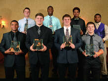 Back row from left, Austin Marshall, Isaih Pouncy, P.J. Locke, Devonta Hawthorne, Josh Breed, Blain Padgett, Roe Wilkins and Colby Choate at the Beaumont Enterprise Super Gold Banquet on Monday.   Photo taken Monday, December 15, 2014  Guiseppe Barranco/The Enterprise