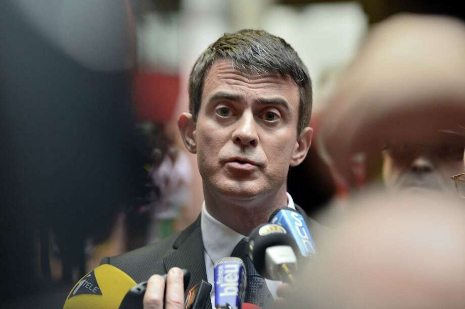 French Prime Minister Manuel Valls speaks to the press as he arrives at the University Hospital Center of Nantes to visit victims of an attack on a Christmas market the night before. Photo: GEORGES GOBET / AFP/Getty Images / AFP