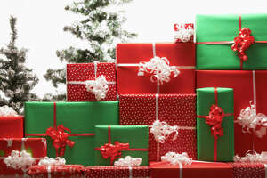 Christmas gifts by tree