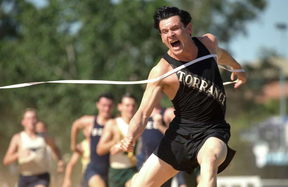 "Jack O'Connell as Louis Zamperini, who made the U.S. track team in the 1936 Olympics, in ""Unbroken,"" which is directed by Angelina Jolie. Photo: David James / Associated Press / Universal Pictures"